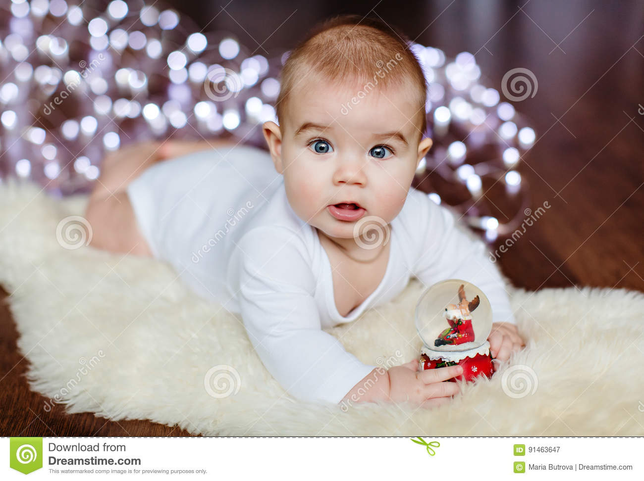 very cute baby lying on the floor on the background of christmas