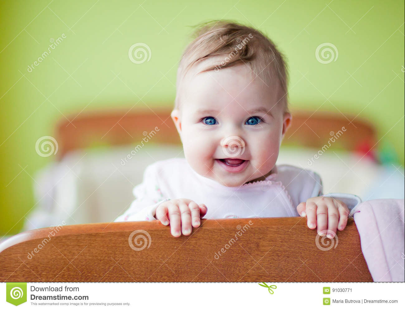 Very Cute Baby Smiles Standing In The Crib Stock Image Image Of