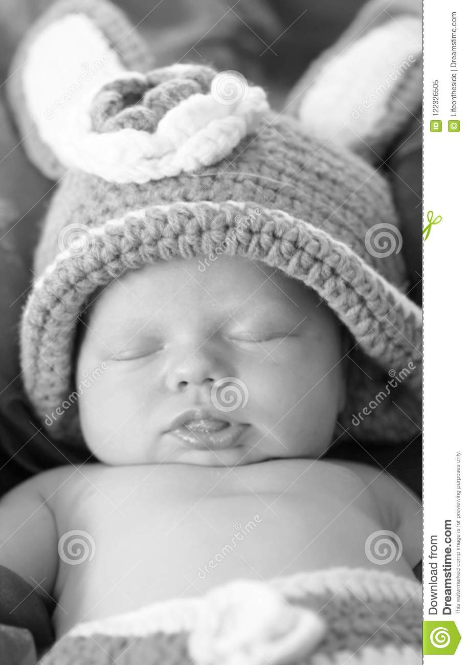 Black white portrait close-up newborn baby sleeping in bunny costume