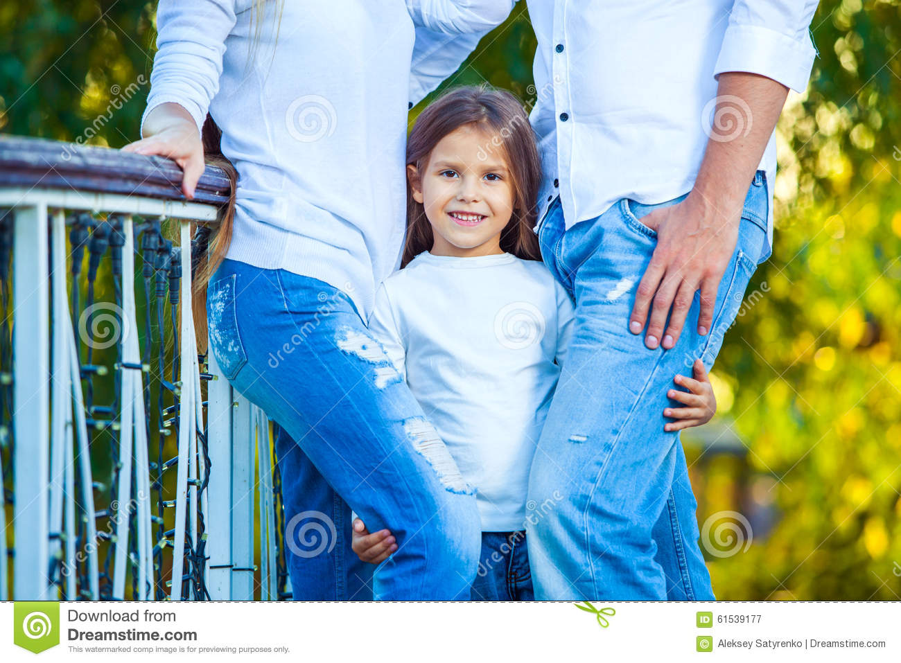Very cute little blonde girl holding the foot mom