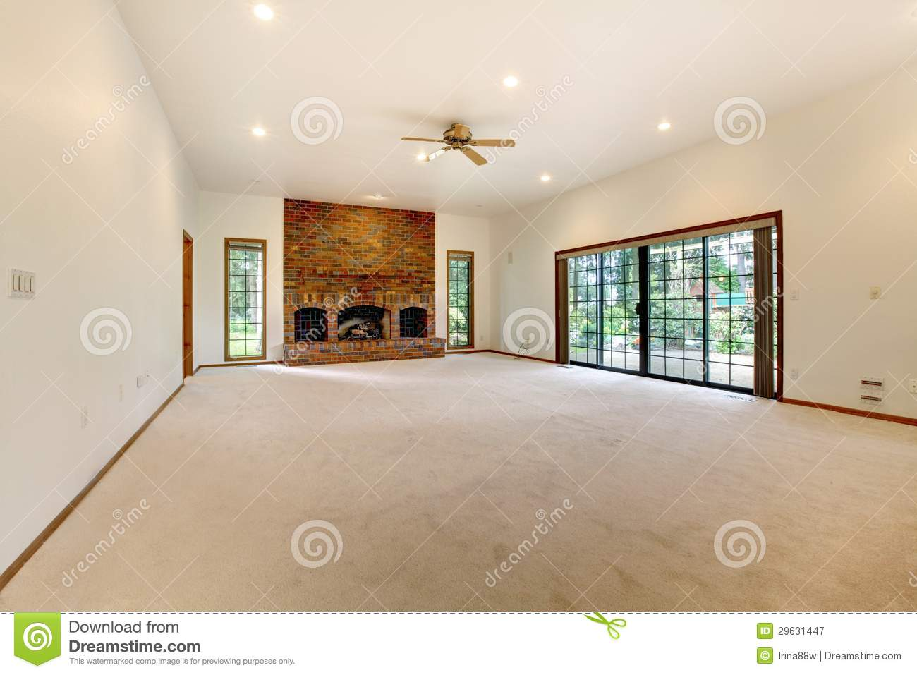 very large empty living room with brick fireplace royalty