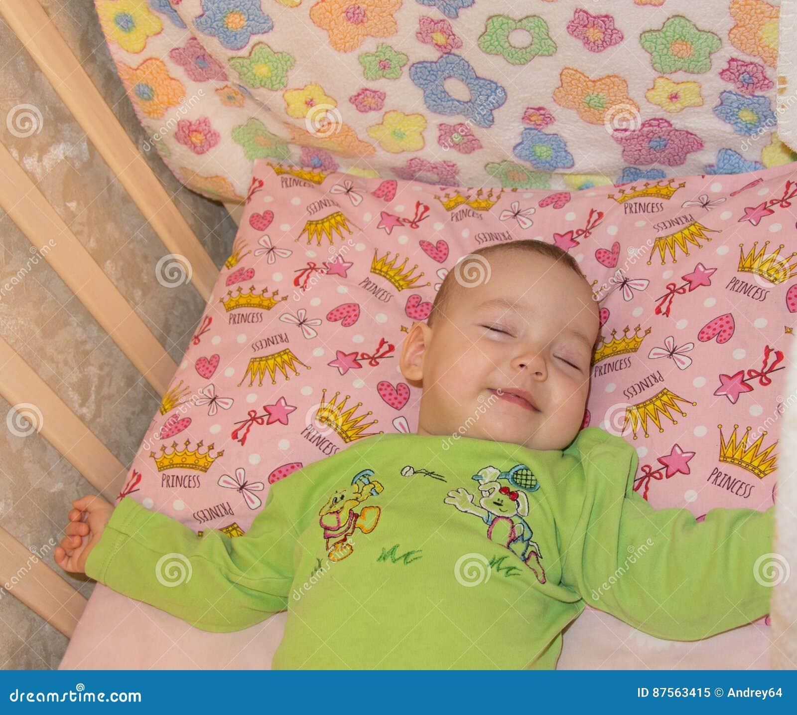 very nice sweet baby sleeping in crib stock image - image of