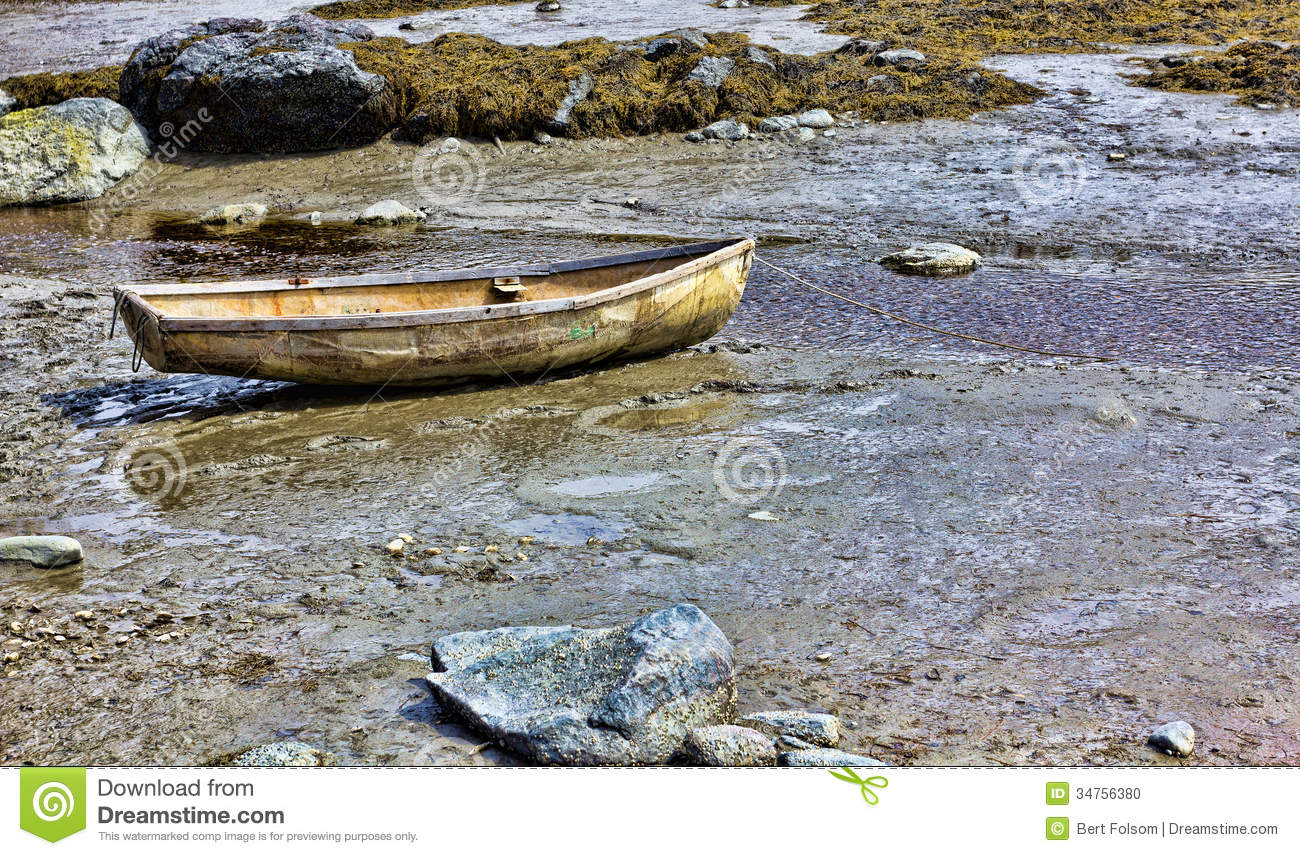 Stock Photo: Very old skiff on shore