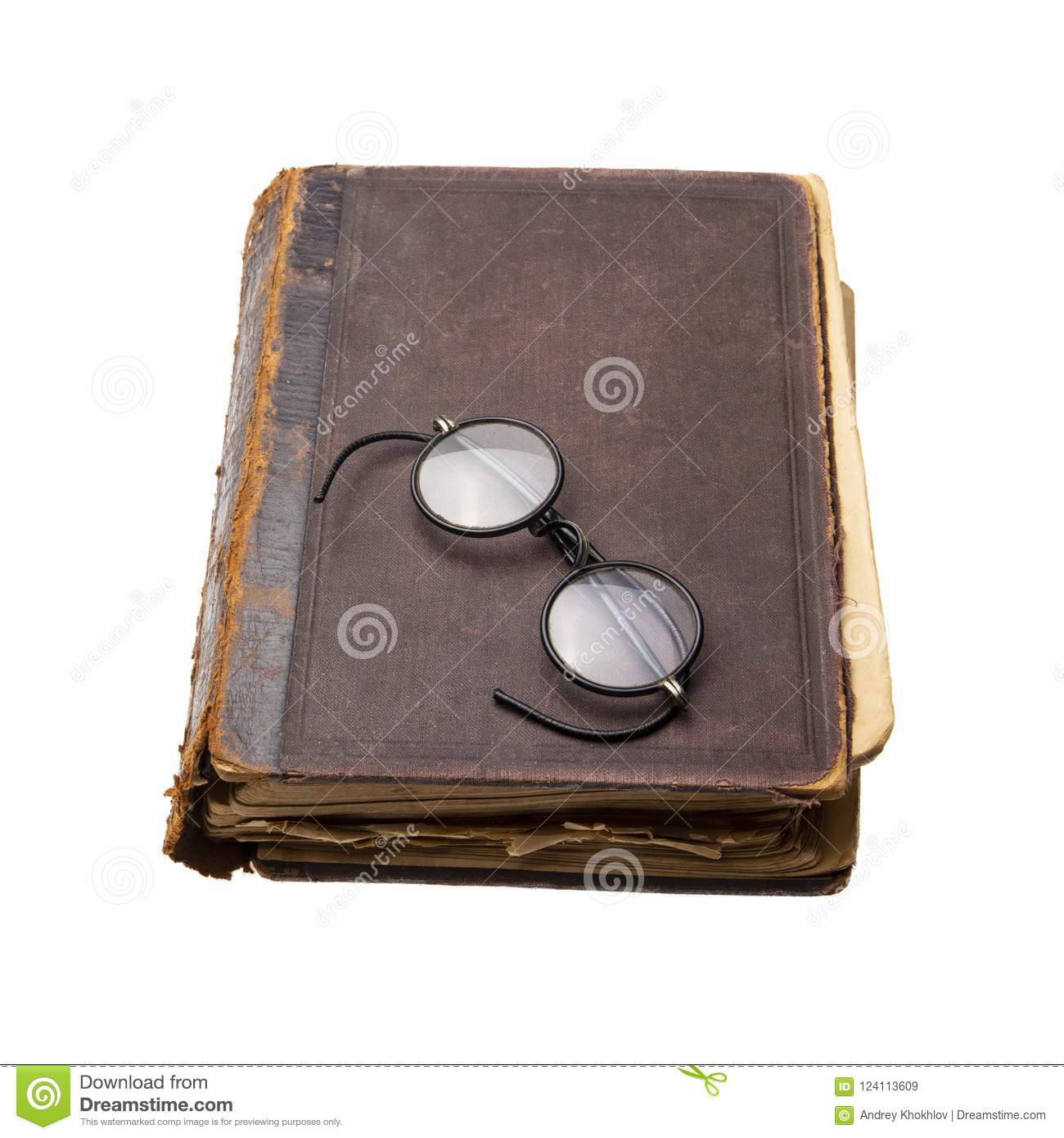 12593ff5b68 Very Old And Worn Book With Antique Round Eyeglasses. Isolated Stock ...