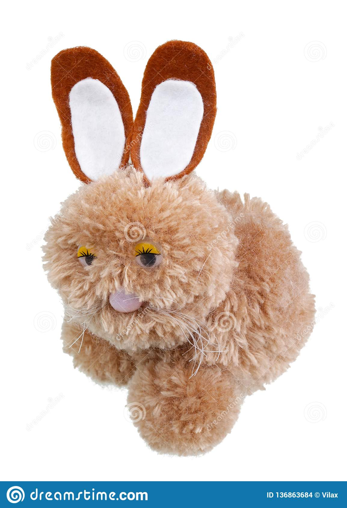 A very sad homemade Easter bunny made of woolen threads isolated