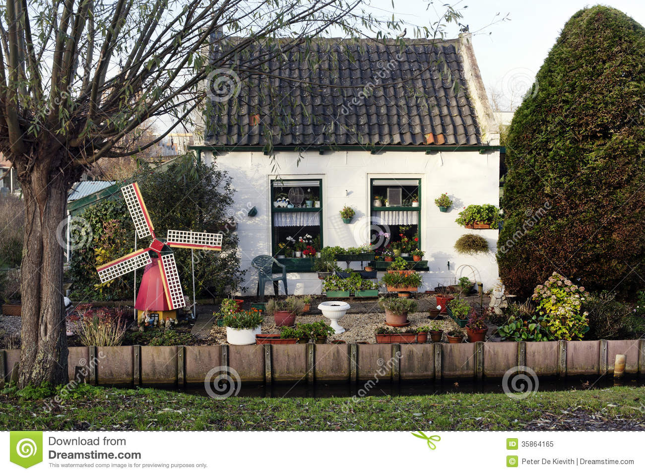 Small garden in front of the dutch house stock photo for Classic dutch house of 60m2