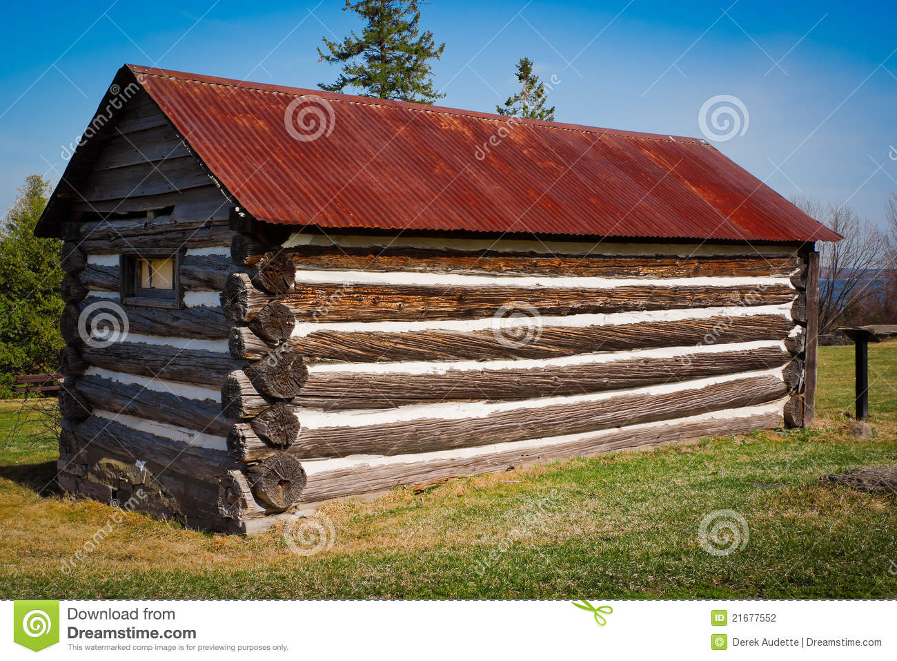 Very small old log cabin with rusted tin roof stock for Very small cabins