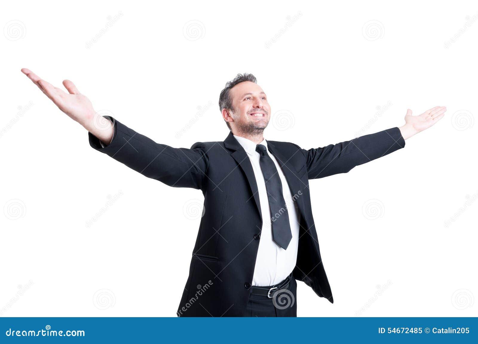 Male supermarket employer holding arms wide open like winner stock.