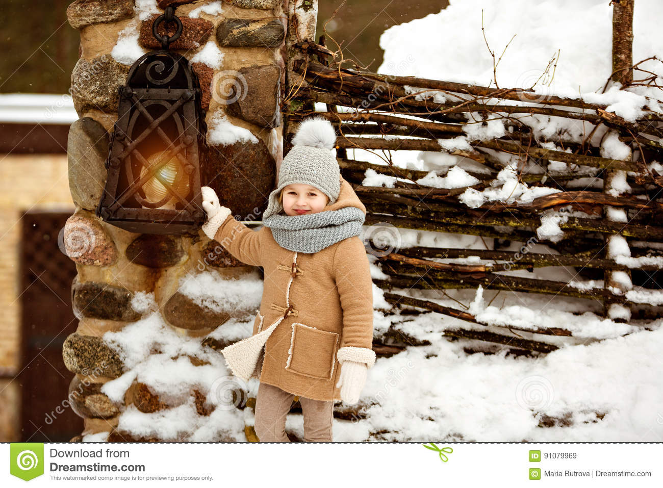 Very sweet beautiful little girl child in a beige coat smiling a