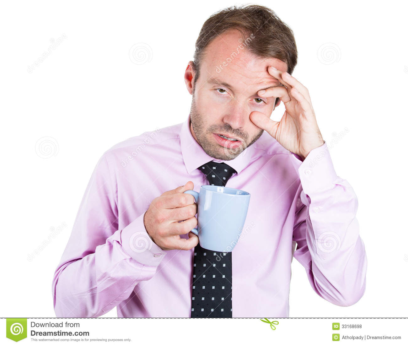 Very tired, almost falling asleep businessman holding a cup of coffee, struggling not to crash and stay awake