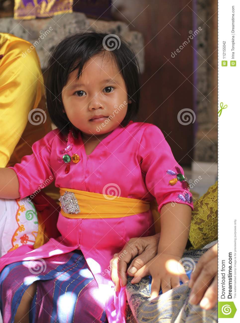 A Very Young Girl In Traditional Balinese Clothes On Potong Gigi