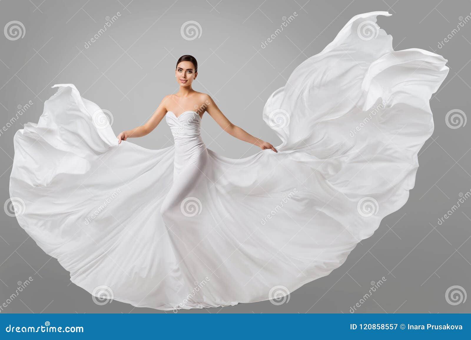 Vestito bianco dalla donna, modello di moda di nozze in abito di seta lungo della sposa