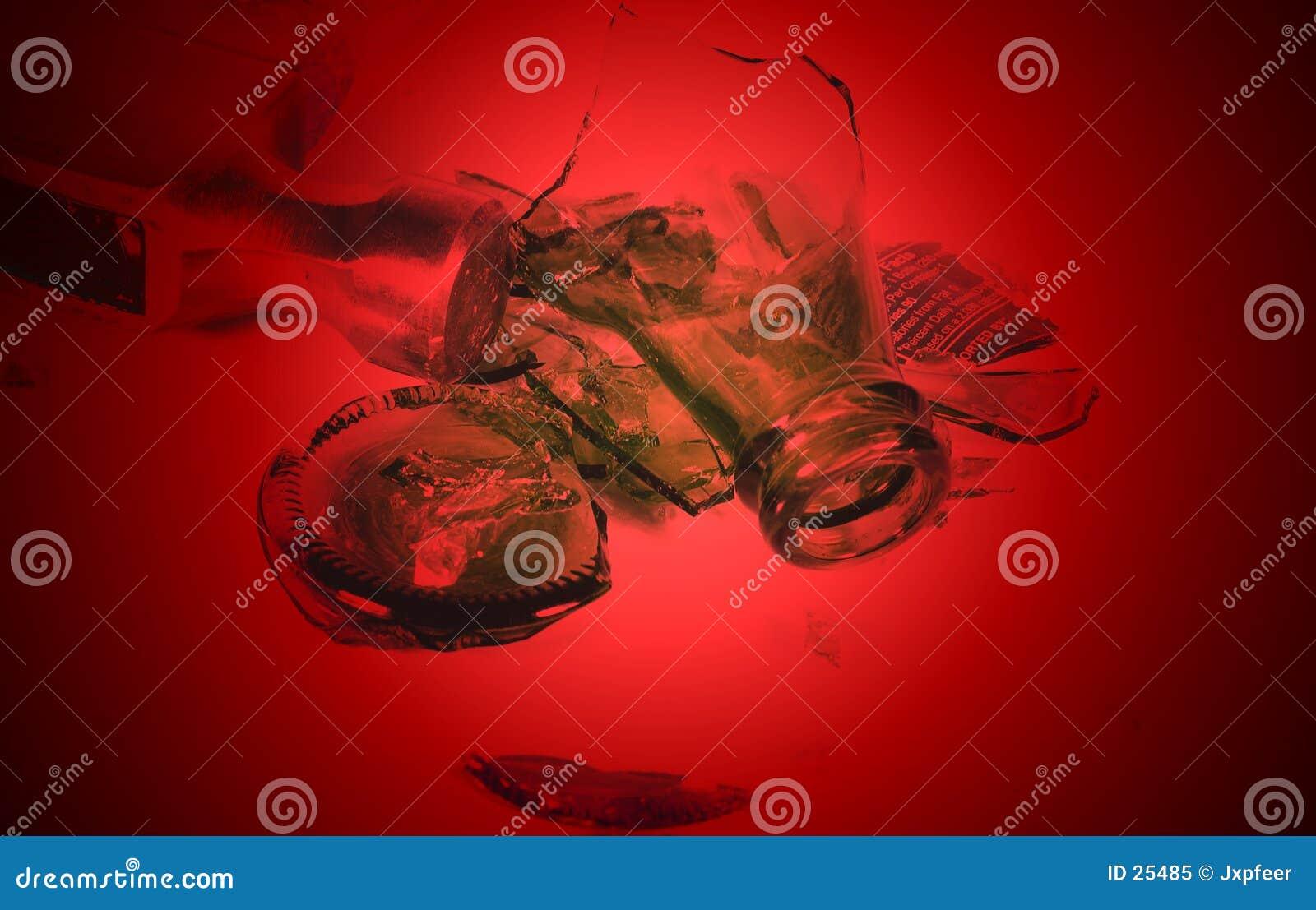 Vetro con il martello, getto di colore rosso
