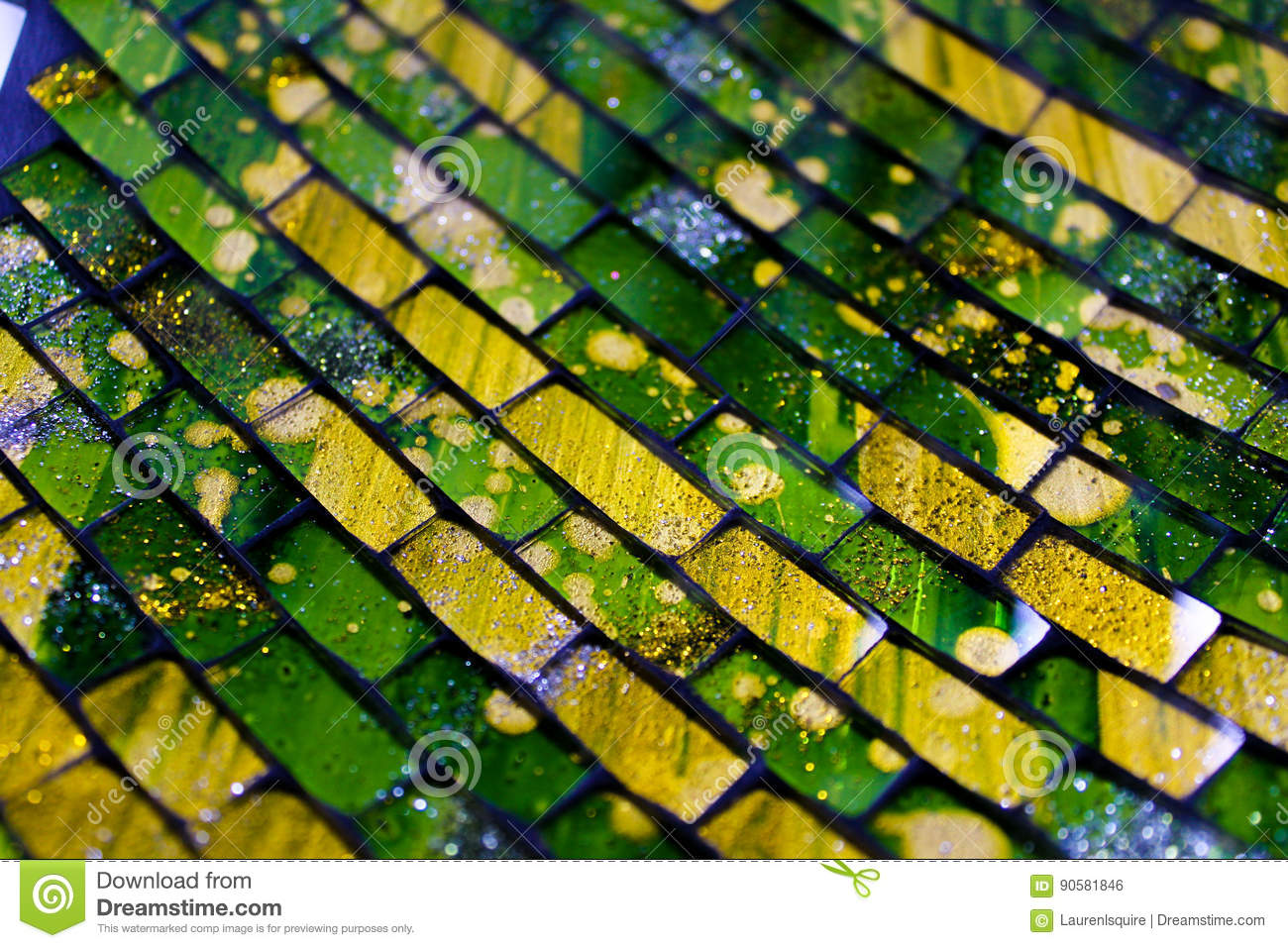 Vibrant ceramic green and yellow tiles on Arabic style dish from Granada