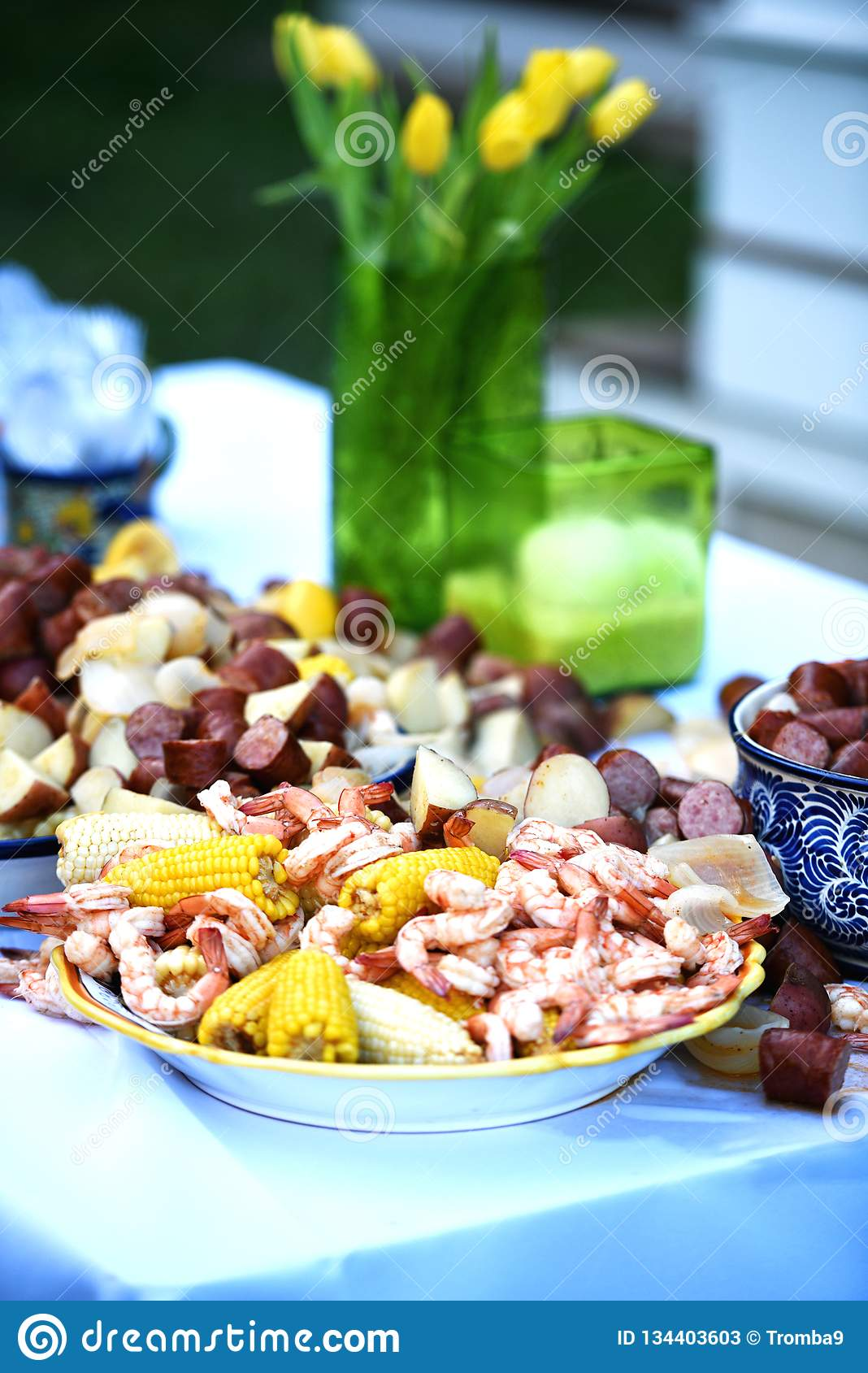 Vibrant color with yellow flowers and a delicious low country shrimp boil.