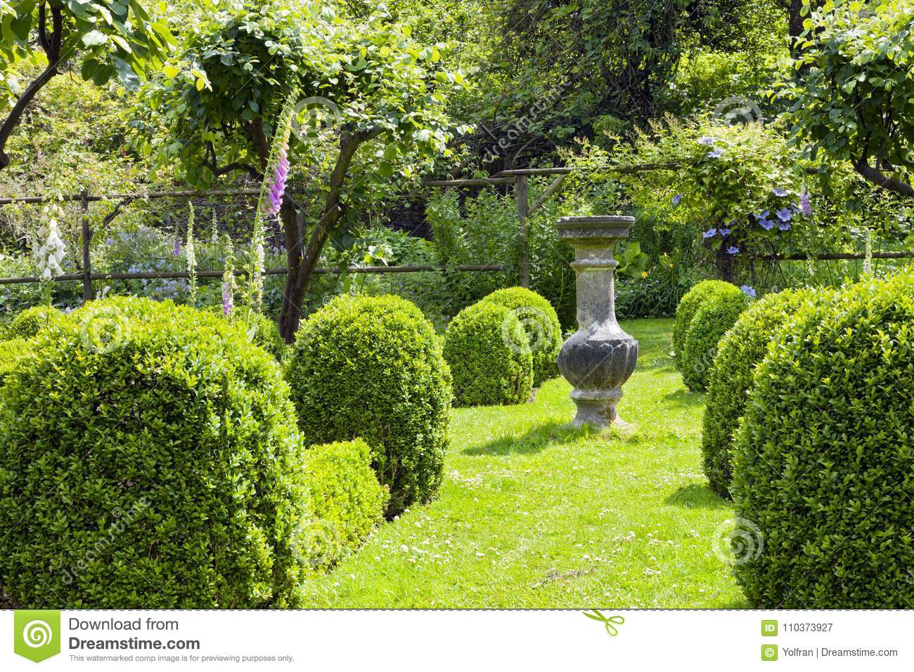 Vibrant Green English Garden With Summer Flowers Stock Image