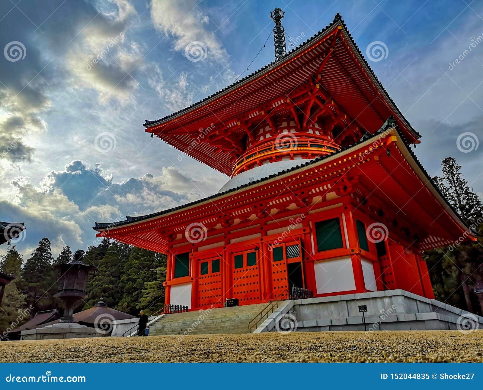 The vibrant red Konpon Daito Pagoda in the Unesco listed Danjo Garan shingon buddhism temple complex in Koyasan, Wakayama, Japan