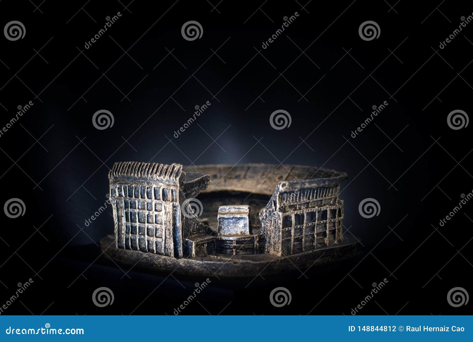 Vicente Calderon football stadium. Golden copy of the famous soccer team Atletico de Madrid stadium over a dark background