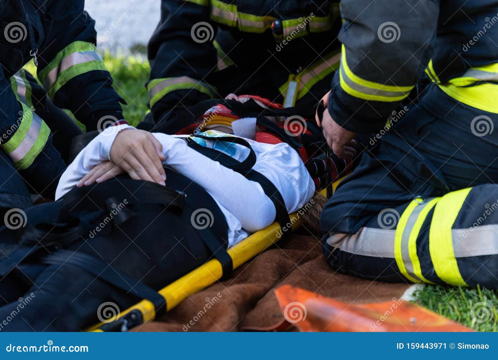 Victim on stretcher stock photo. Image of paramedic
