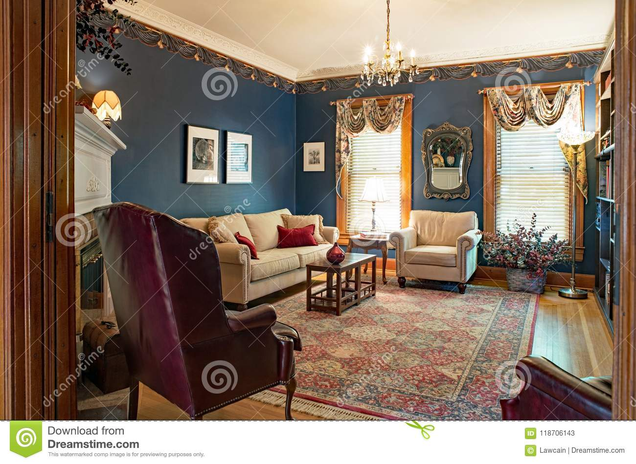 Dayton Ohio USA - June 10 2018 Ex≤ of Victorian living room with navy blue walls ten foot ceiling crystal chandelier and oriential area rug in one ... : victiorian living room - amorenlinea.org