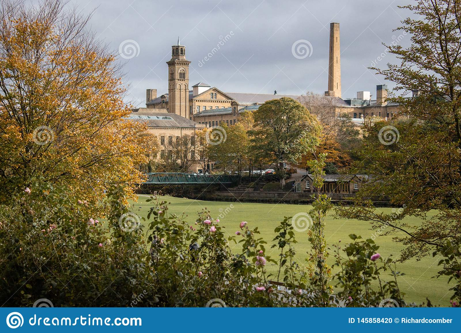 Victorian model village of Saltaire glimpsed through the trees