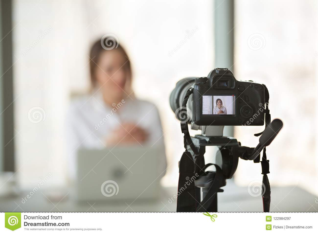 Video camera filming live training of successful business coach