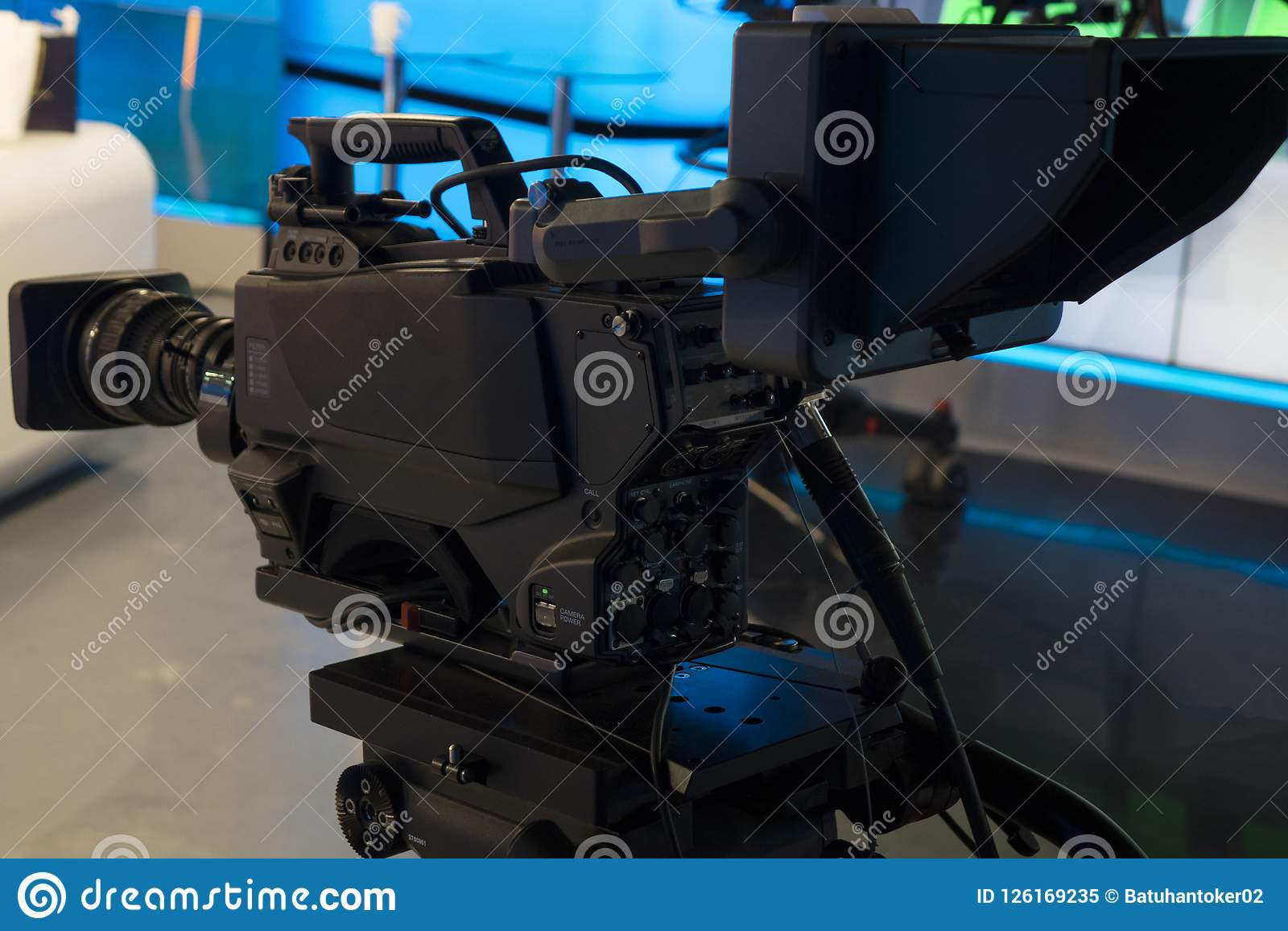 Television studio with camera and lights - recording TV show. Shallow depth of field