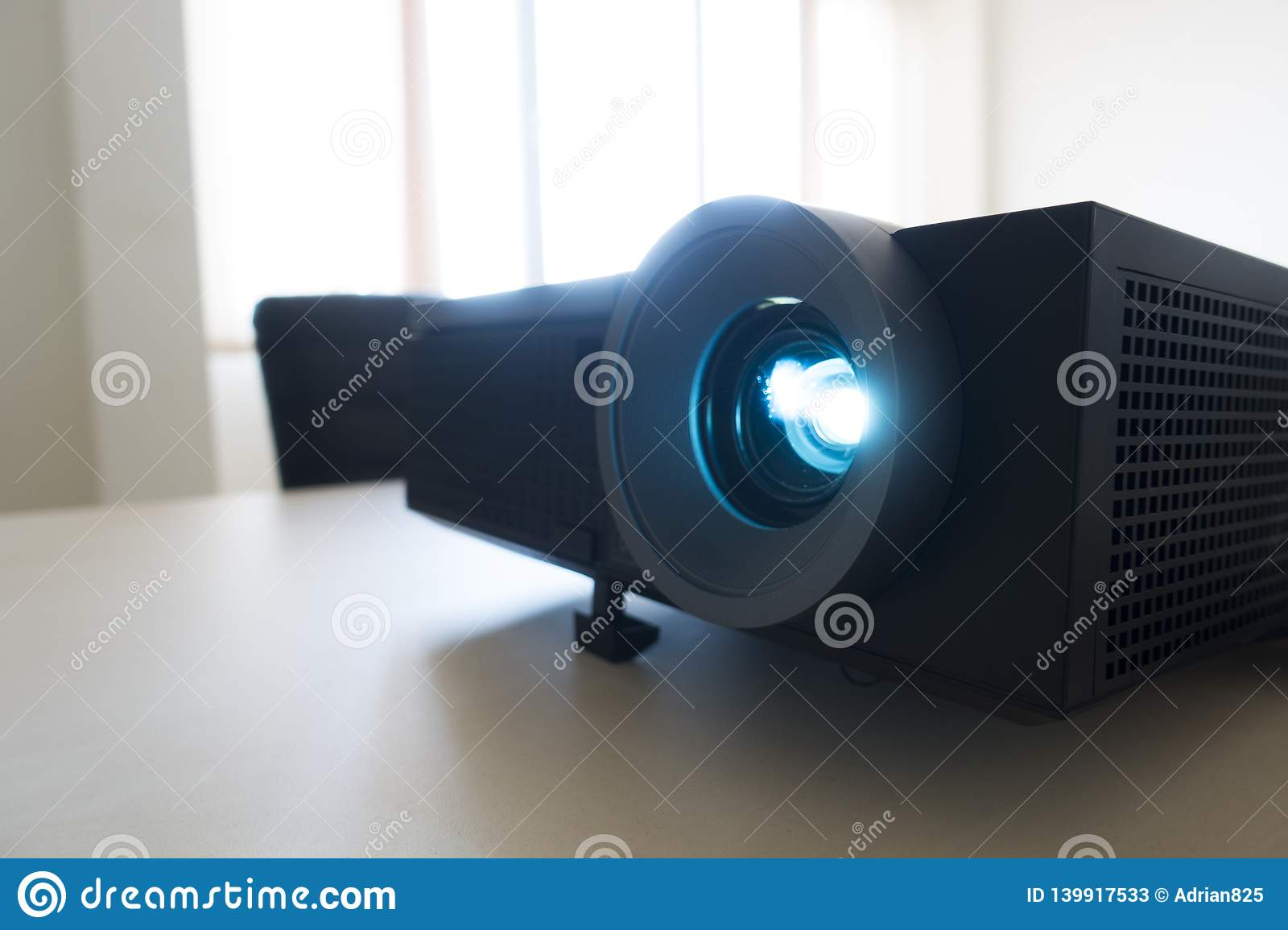 Video projector in business meeting, projecting a presentation
