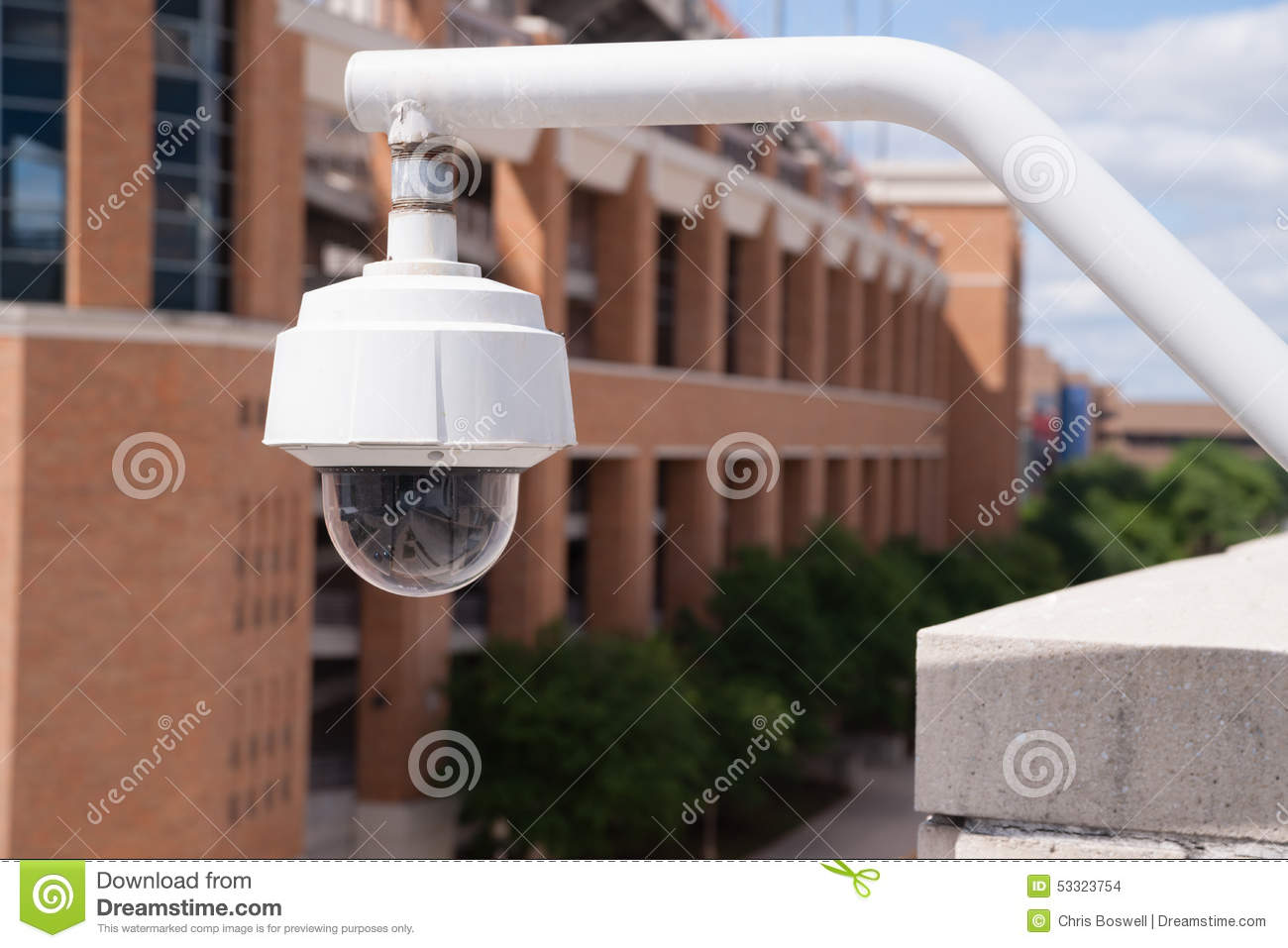 Video Security Camera Housing Mounted High On College