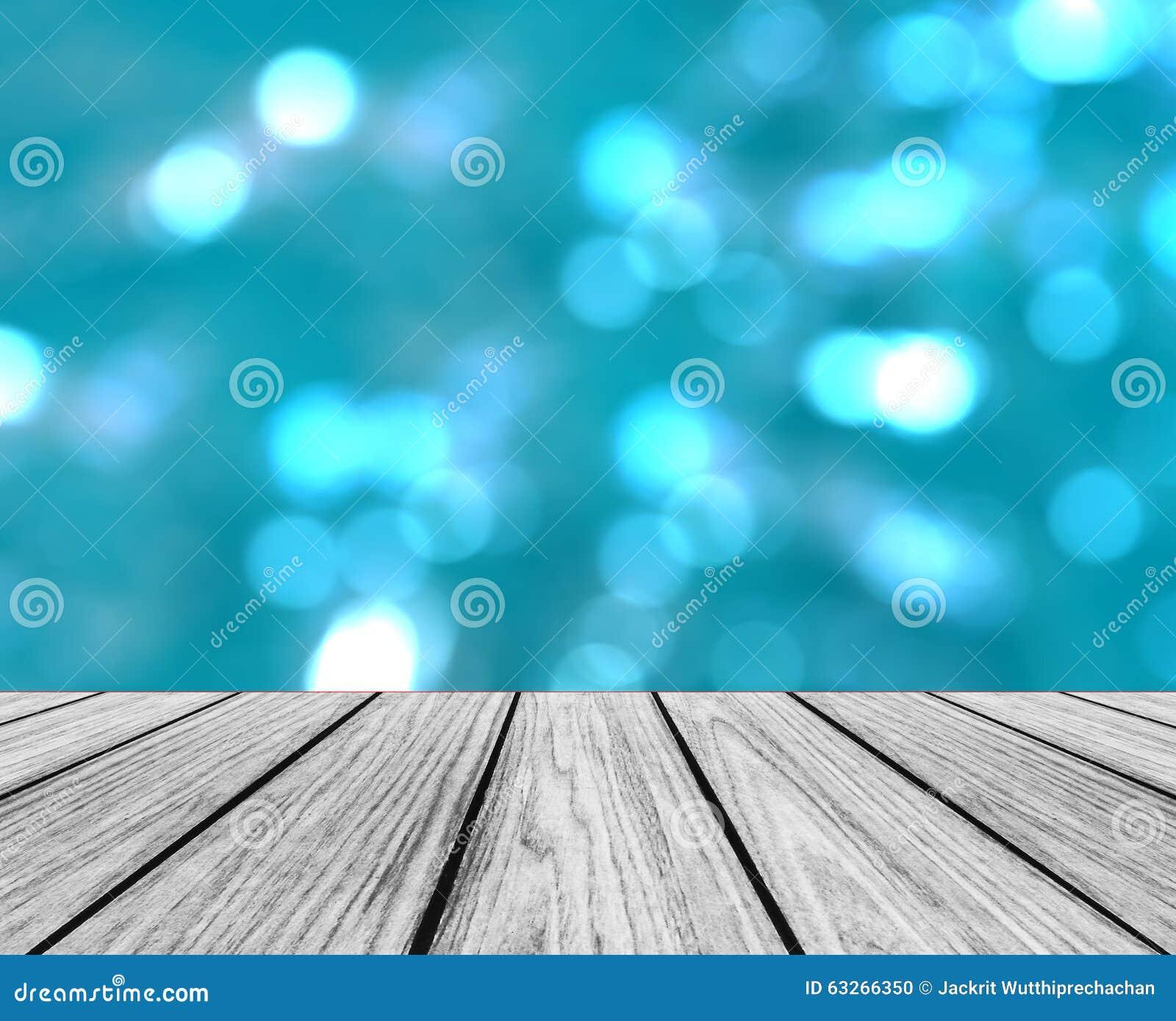 Videz la plate-forme en bois de perspective avec le fond clair rond coloré abstrait de scintillement de cercles de Bokeh utilisé
