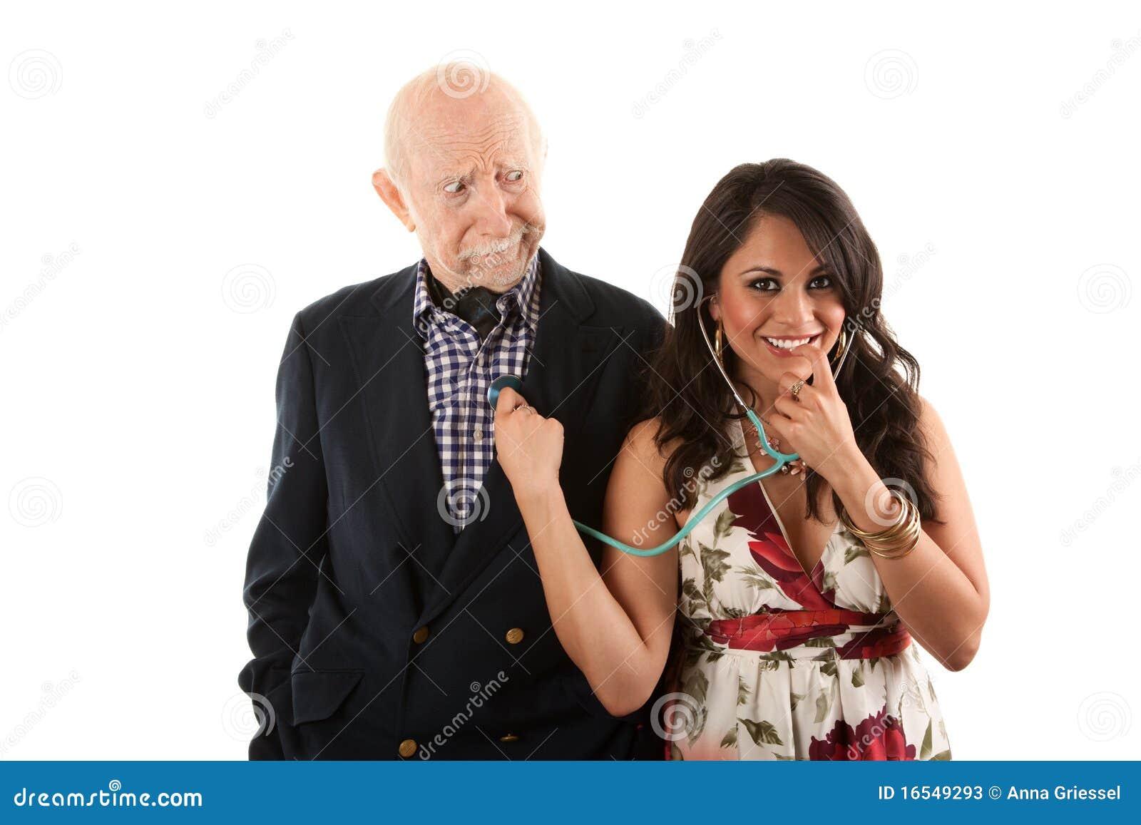 Vieil homme avec l accouplement ou l épouse d or-bêcheur