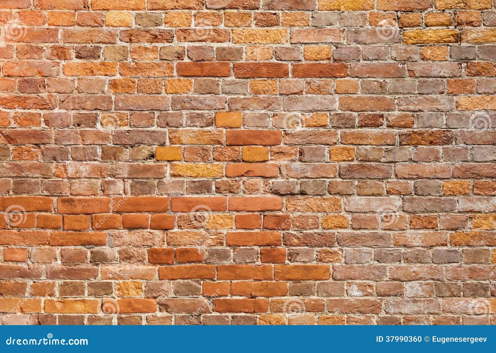 Vieille texture rouge détaillée de fond de mur de briques