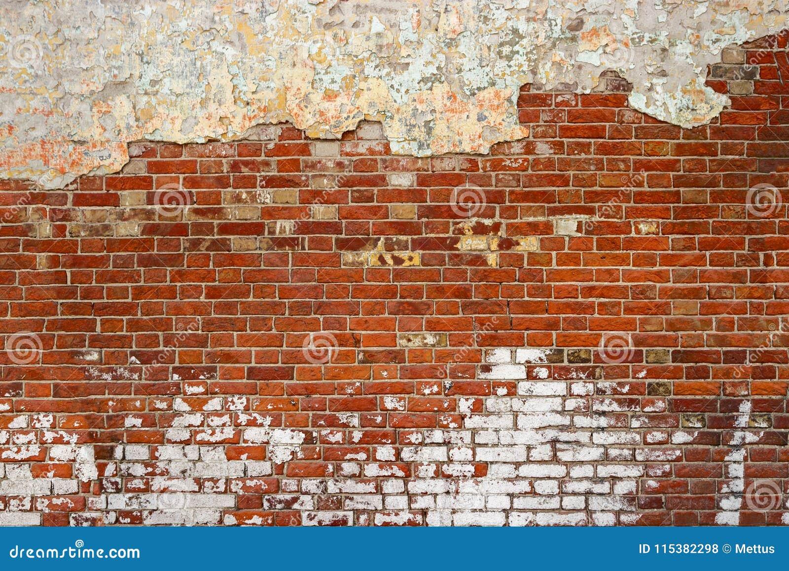 Vieille texture vide de mur de briques Surface affligée peinte de mur Le rouge grunge monopolisent la parole le fond Façade minab