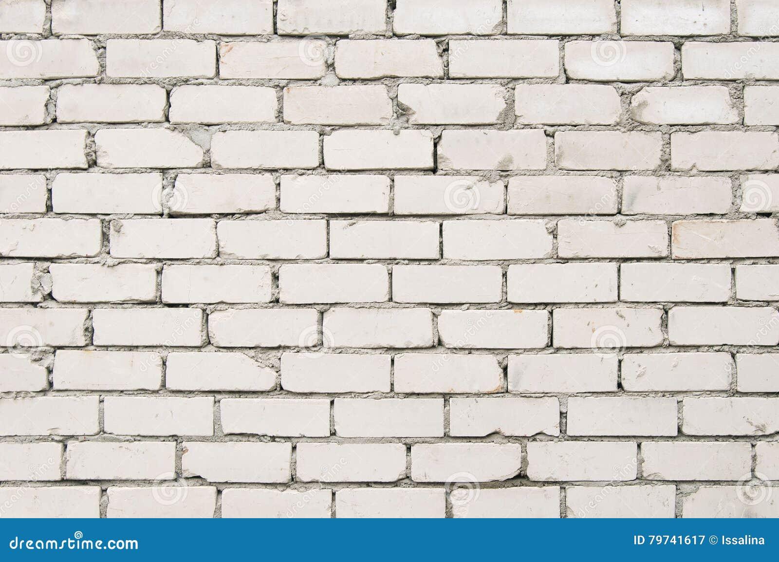 Vieja textura blanca del fondo de la pared de ladrillo