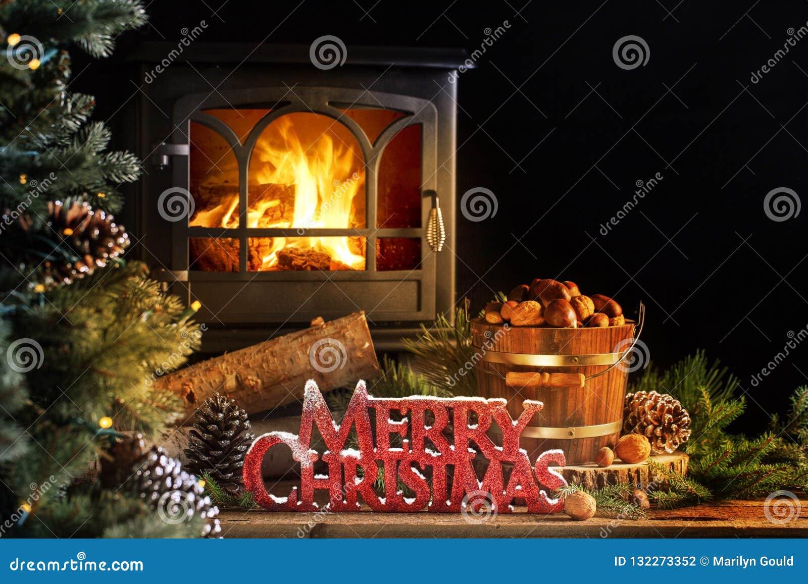 Viejo saludo de madera de la Feliz Navidad de la estufa