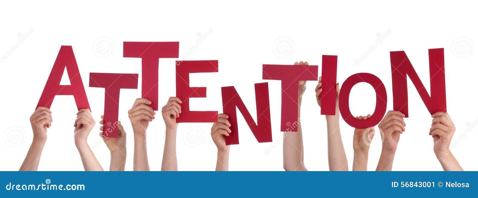 Viele Leute-Hände, die rote Wort-Aufmerksamkeit halten