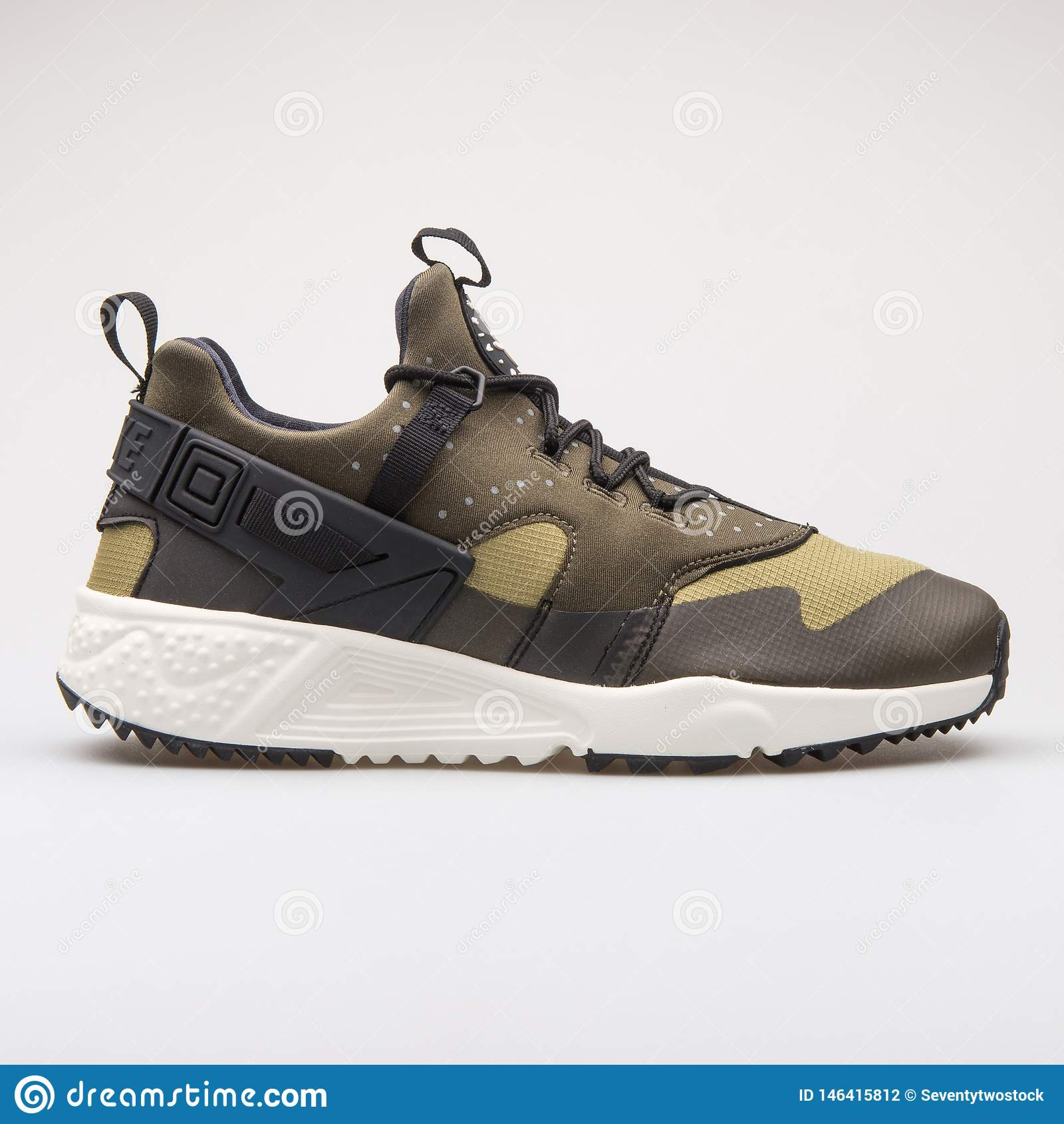 Nike Air Huarache Utility Black And Green Sneaker Editorial ...