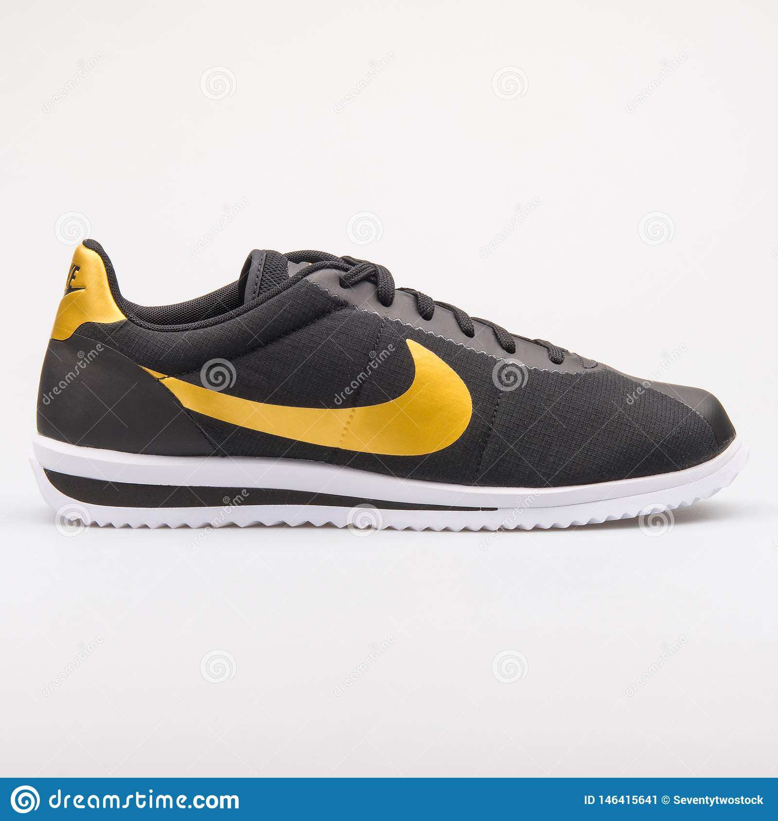 new product a99dc f6b9c Nike Cortez Ultra QS Black And Gold Sneaker Editorial Photo ...