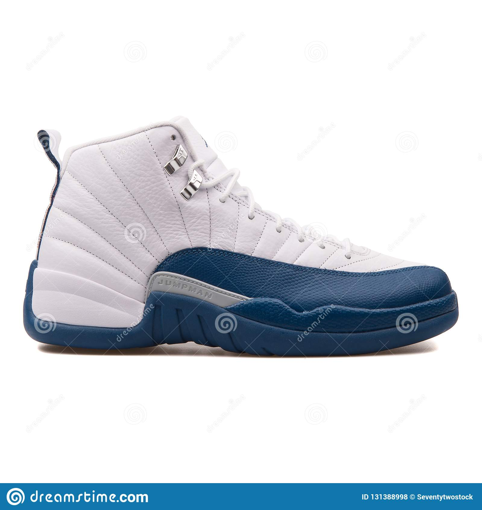 9ed938c38c5 Nike Air Jordan 12 Retro metallic silver and french blue sneaker isolated  on white background