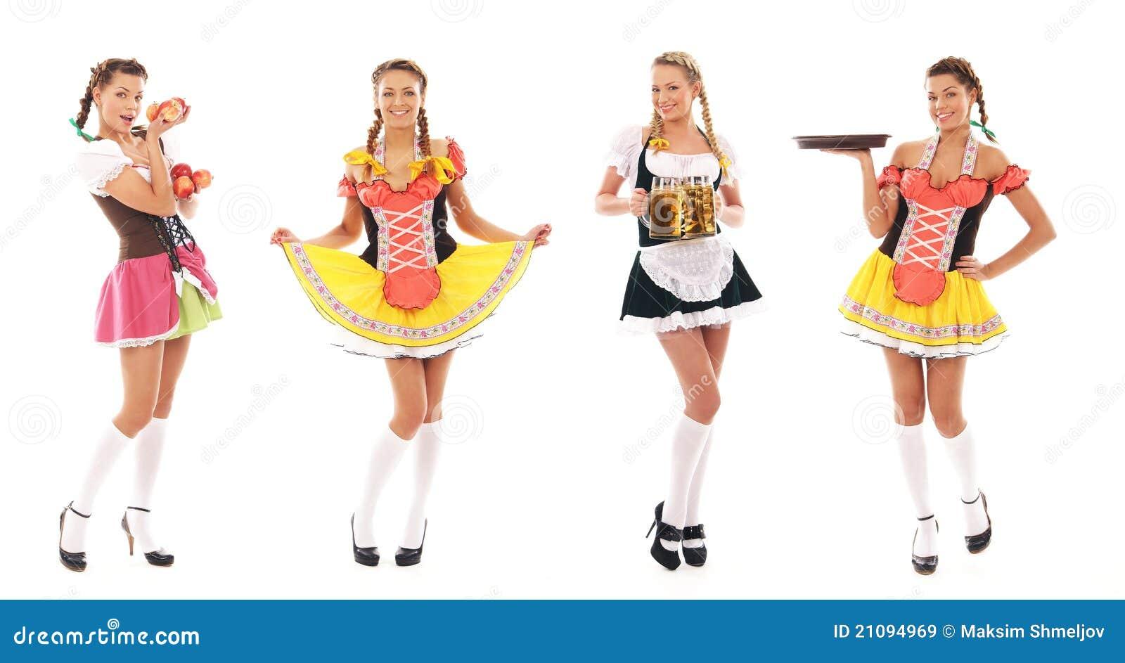 eeeef1bdd4e4d1 Vier jonge en aantrekkelijke Beierse meisjes die in sexy kleding stellen en  verse appelen houden. Het beeld is geïsoleerde op een witte achtergrond.