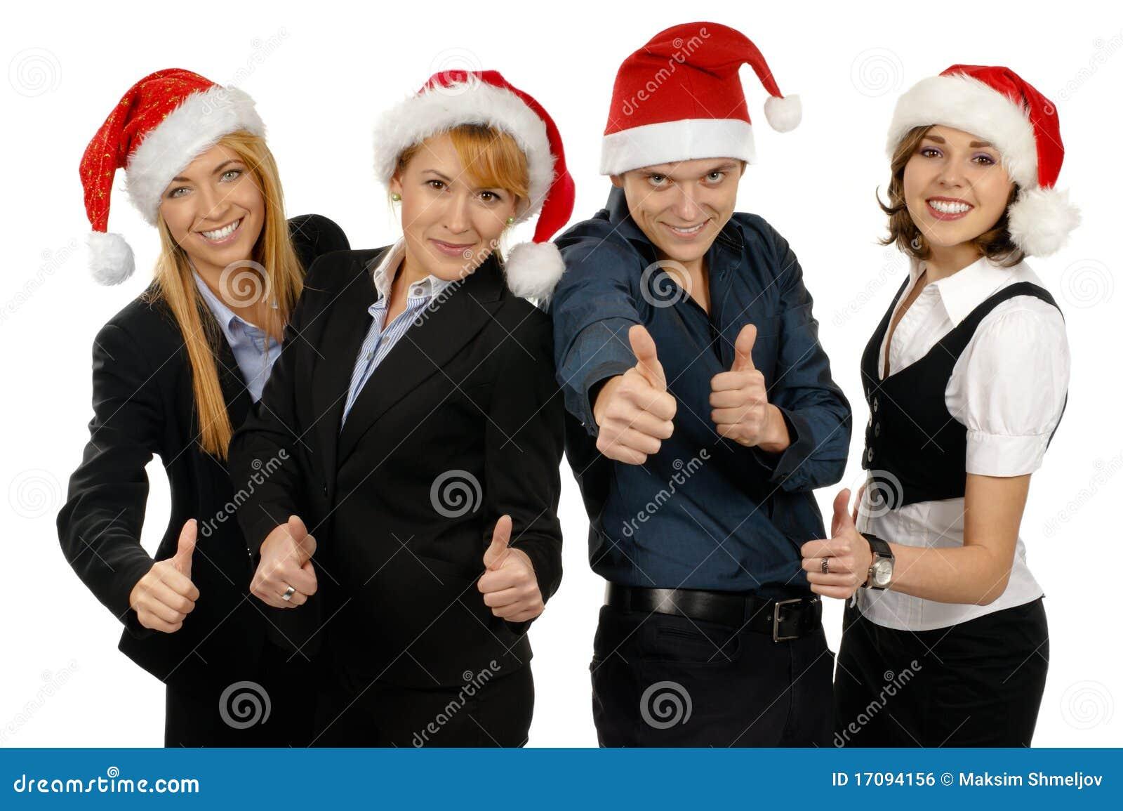 Vier junge businesspersons in den Weihnachtshüten