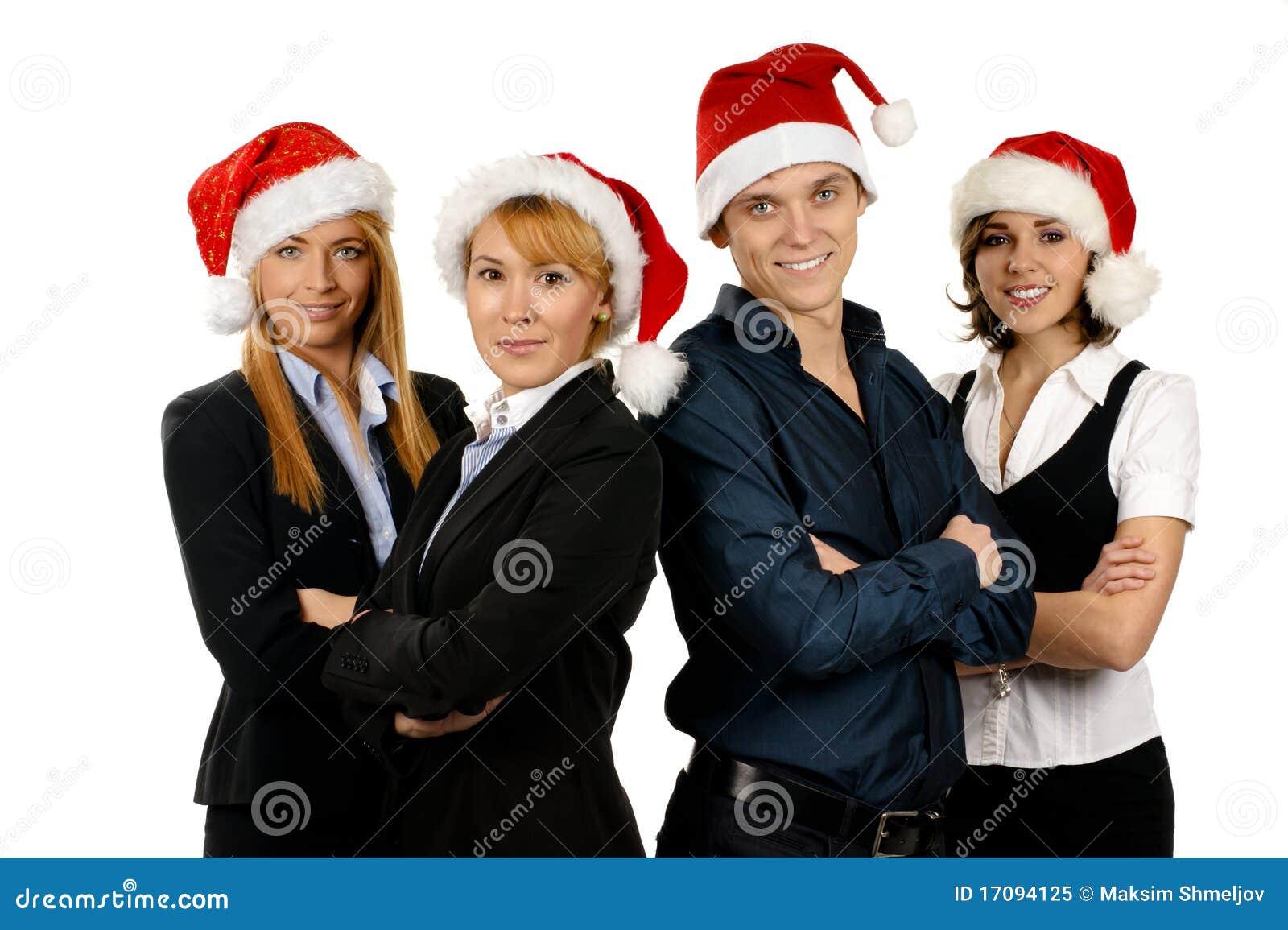 Vier junge Geschäftspersonen in den Sankt-Hüten