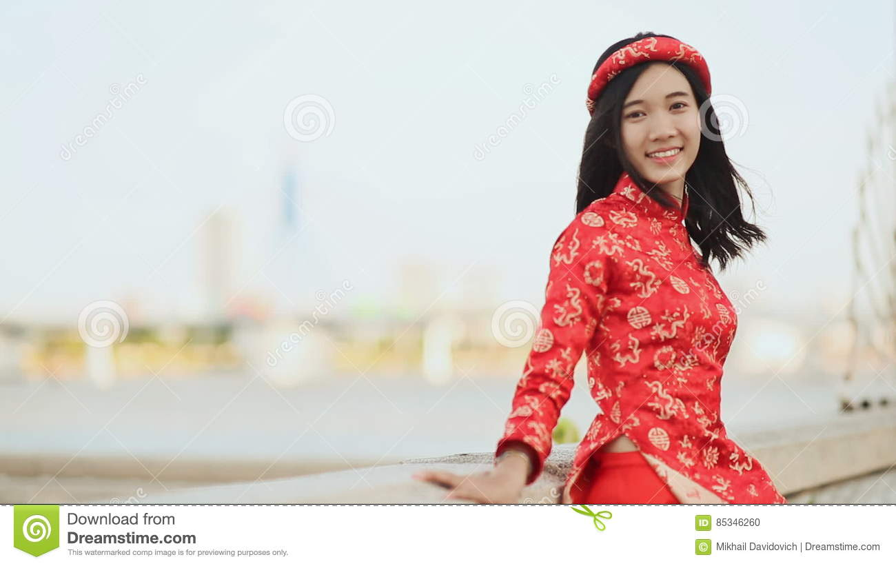Vietnam girl in the national red dress ao dai posing and smiling for vietnam girl in the national red dress ao dai posing and smiling for the camera stock footage video of flower adult 85346260 ccuart Gallery