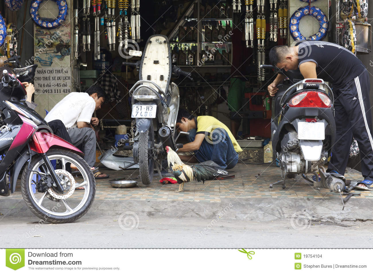 Vietnam motor bike repair editorial stock image image of for Motorized bicycle repair shop