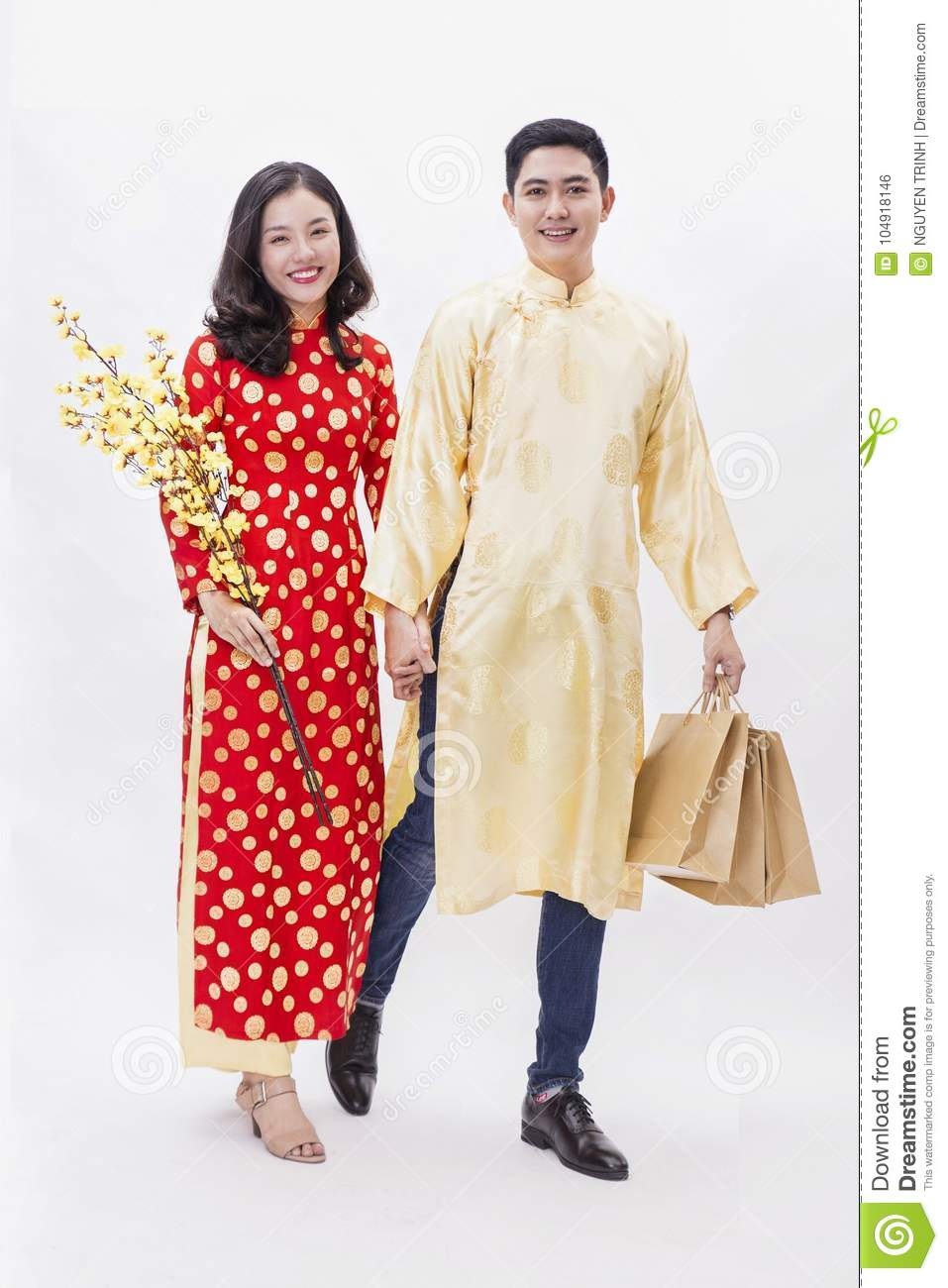 e44546fda Vietnamese asian girl wearing traditional dress for lunar tet new year and  holding a phone