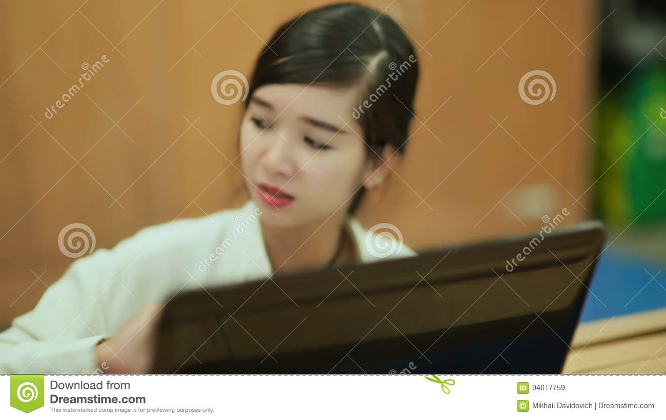 Vietnamese girl working at a laptop stock video video of education vietnamese girl working at a laptop stock video video of education casual 94017759 ccuart Gallery