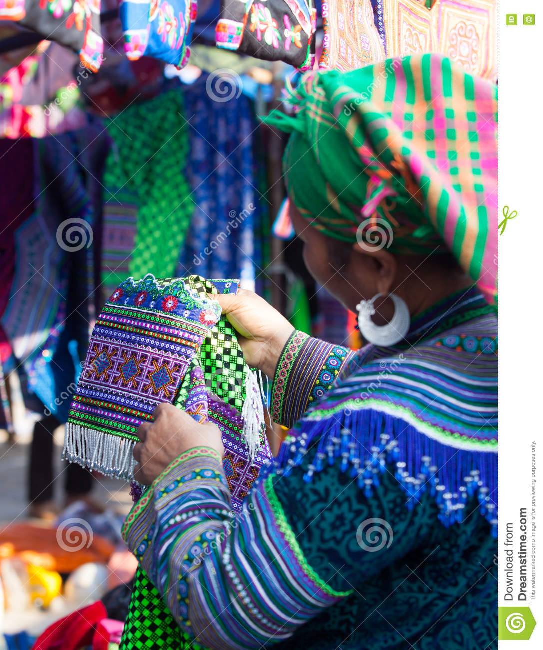 Vietnamese Hmong minority woman trying new traditional costume