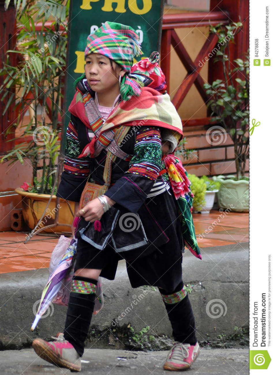 Vietnamese Hmong Woman Carrying Her Child Editorial