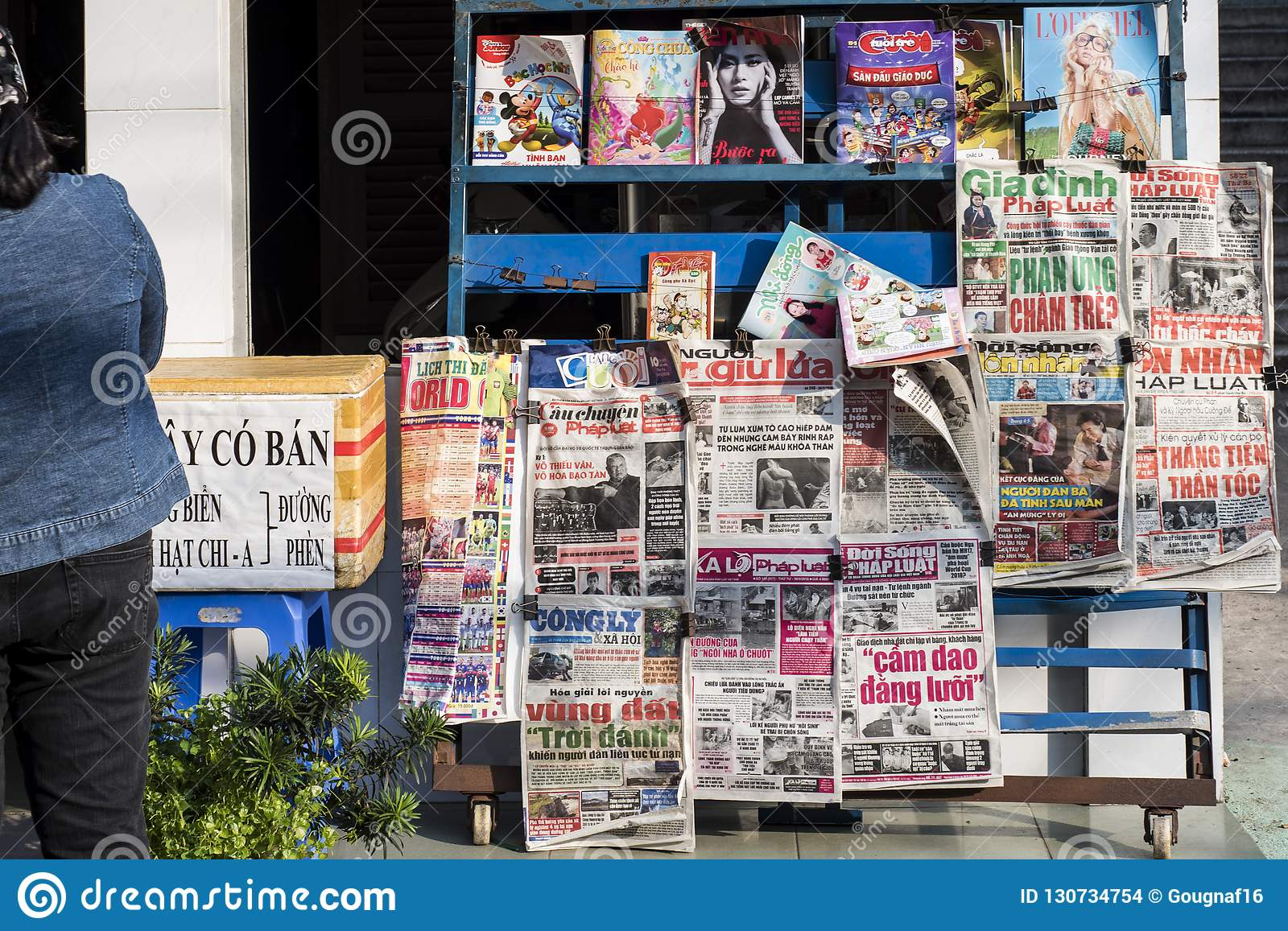 Vietnamese newspapers and magazines on a stand in a street of Ho Chi Minh City in Vietnam.