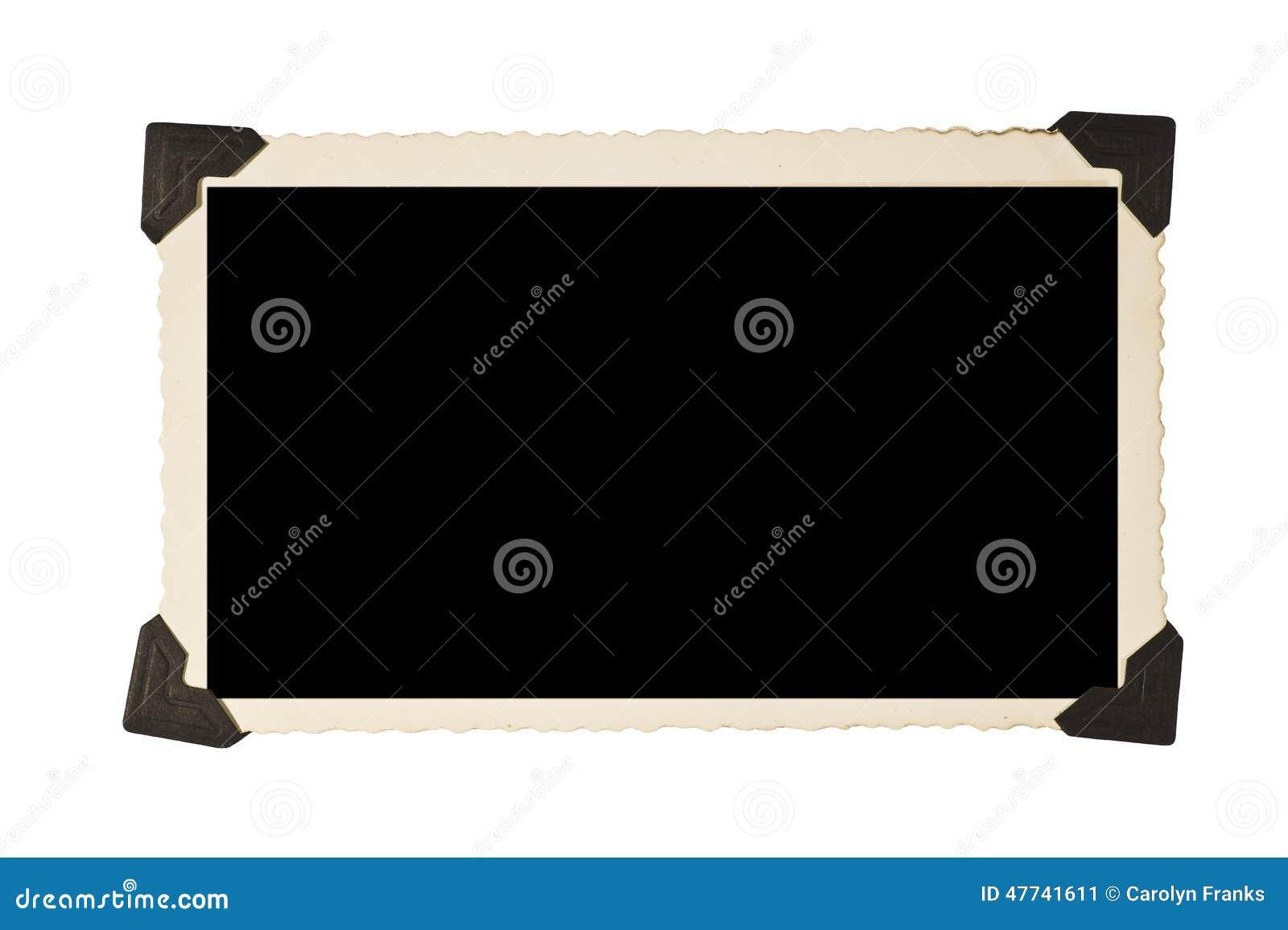 Vieux cadre de tableau rectangulaire avec des coins de photo